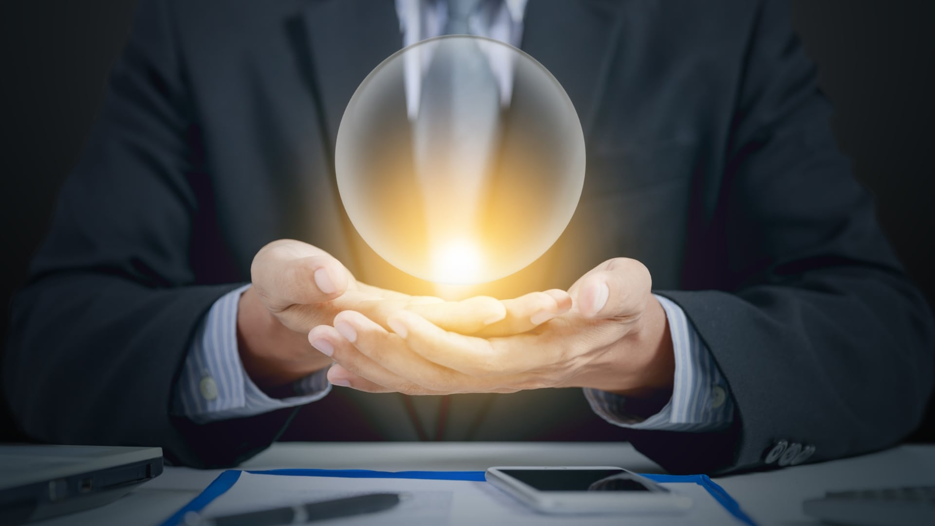 Business man with crystal ball